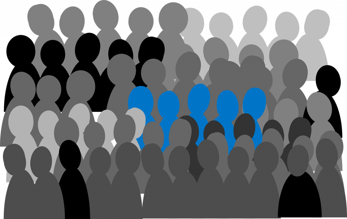 Vector image of several blue people standing out from the crowd of grey ones